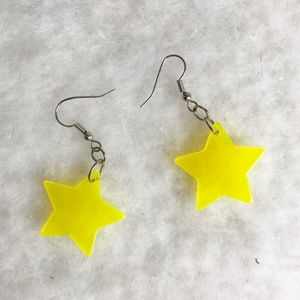 Plastic clear yellow star earrings